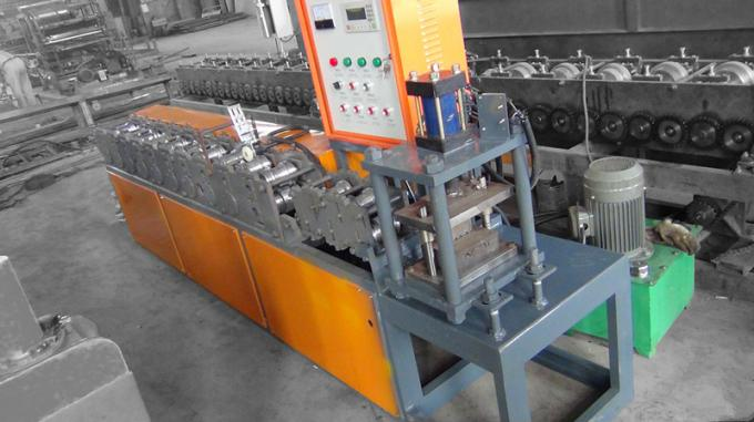 dixin steel roller shutter door frame roll forming machine supplied by manufacturer